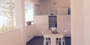 Appartamento con angolo cottura in veranda